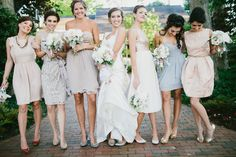 Love the pastel bridesmaids' dresses!   See more spring wedding goodness here: http://www.StyleMePretty.com/2014/05/22/pastel-spring-wedding-in-chapel-hill/ Photography: MichelleLyerly.com