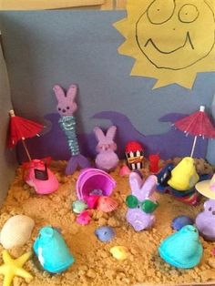 2013: Chillin' with my peeps at the beach    Beach scene designed by 6 year old Bryn Smeltzer, there is a mermaid peep and peeps reading and relaxing in the sand.