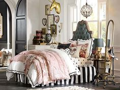 I love everything about this room!!!! Ahhh the black and white strips with the black hearts and splash of pink