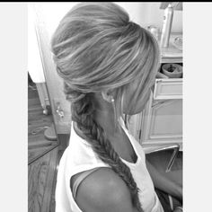 Prom hair! Teased, fishtail braid swept to the side...perfect for a backless dress! :)