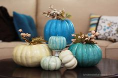 Vibrant Color Pumpkins: paint fake pumpkin with craft paint; allow to dry; add a layer of extreme glitter acrylic paint for sparkle; allow to dry; if desired, remove stem from fake pumpkin (before painting), & replace (through the hole) with stems of decorative holiday picks of berries, balls, leaves, flowers, etc.