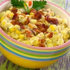 Slow Cooker Creamed Corn with Onion and Chives | Corn is simmered in a creamy bacon sauce in the the slow cooker for a make-ahead side dish perfect for weeknights.