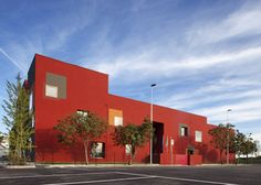 Primary school featuring a colourful facade with contrasting window details.