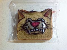 Dad draws pictures on his sons' sandwich bags every day to show his love. And imagination. And sense of humor. And awesomeness.