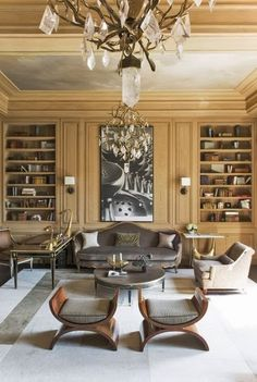 Library/Den - Custom paneled walls with built ins, all wrapped in a warm palette..