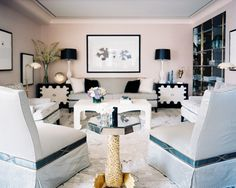 Living Room Photo - A black-and-white color palette in an open living space