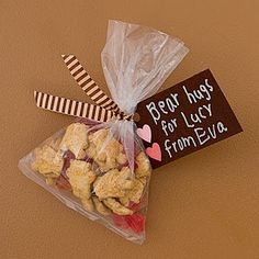 Teddy Grahams + heart candy = bear hugs. Pass out after chapter meeting around Valentine's Day!