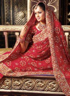 Beautifully crafted Indian wedding dress. The use of red in Indian weddings is meant to associate the bride with Durga, the Hindu goddess who represents power, strength and valor.  #Hindu #Culture #Tradition #IndianWedding #Textiles