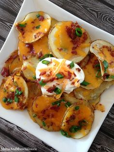 Loaded Baked Potato Nachos Recipe - Highly addictive recipe that taste just like baked potatoes but in a fun nacho version that are perfect as a party appetizer.