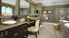 Toll Brothers Luxurious master bath with dual oval sinks, vanity