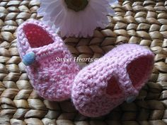 These little pink handmade crochet baby Mary Janes shoes are perfect for Easter dresses & outfits!  They have little colored Easter egg buttons that fasten them to little feet! So cute!    Please stop by my Etsy shop at www.etsy.com/shop/sweetheartsandsoles for more baby booties, as well as baby & toddler accessories!