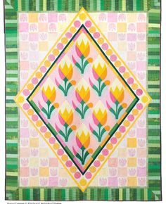 = free pattern =  Tulip Garden quilt by Hallie O'Kelley at American Quilters Society