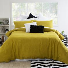 The on trend colour of the past few season has been mustard yellow, and it doesn't seem to be going away. Our Stone Washed Linen Mustard Quilt Cover by Muse, can be perfectly decorated with black and white chevron patterns - #PillowTalkHome
