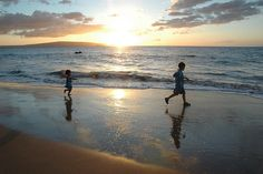 Follow me -- our kids' silhouette captured in front of a timeless hawaiian sunset. Ah, we just gotta go back...
