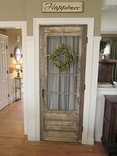I saw this today when I logged in Pinterest, but then couldn't find it to pin it!  (found on line) I've seen a lot of old doors used for pantries, but this is my fav so far!  Love it!