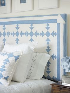 A quilt-covered headboard adds a cozy element to any bedroom.