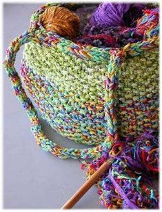Colorful Knit Tote Bag- easy-   Knit a large tote bag to hold all your skeins of yarn for a project on the go. This tote bag knitting pattern features a colorful yarn you will want to display.