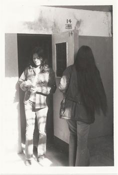 My sisters Karen Harrison (Willie) and Linda Willie inspecting the Hole in D Block on Alcatraz.