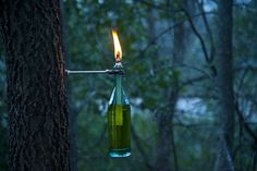 DIY wine bottle torch.  I need to have some of these outside.