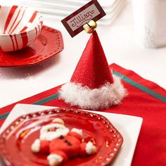 We love these adorable Santa-Hat Place Cards! They can double as thoughtful party favors too: http://www.bhg.com/christmas/crafts/here-comes-santa-claus/?socsrc=bhgpin110613santahatplacecards&page=7