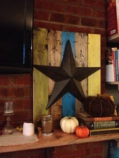 Rustic barnstar on barn wood - created using distressing, paint, and stain | The 20 Somethings - Fall and autumn decorating ideas. Rustic home decor. DIY home decor. Rustic fall decor.