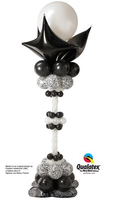 This timeless black and white balloon column features a #damask pattern that's perfect for elegant #wedding decor.  #balloon-column #balloon-decor #balloon-wedding-decor #balloon-wedding-column