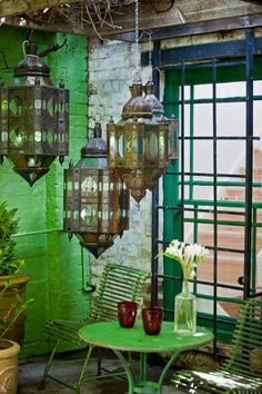 this in a slightly larger scale for dining room/eating area. green + Moroccan lamps + plants.