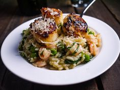 Seared Scallops with Shrimp, Herb and Spring Vegetable Risotto via Barbells and Bellinis