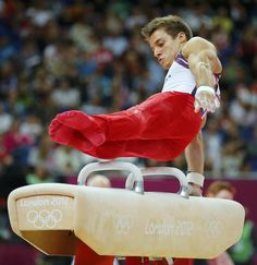 Samuel Mikulak of the U.S.competes in the pommel horse during the men's gymnastics team final in the North Greenwich Arena during the London 2012 Olympic Games
