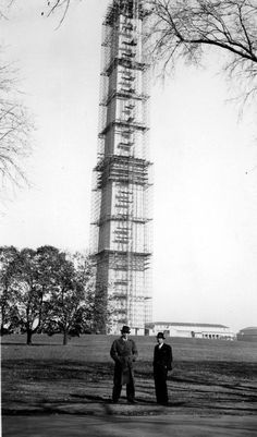 Bok Tower under construction, with scaffolding, Myron Munson and Willie LeFever standing in front. [Munson was Francis's...