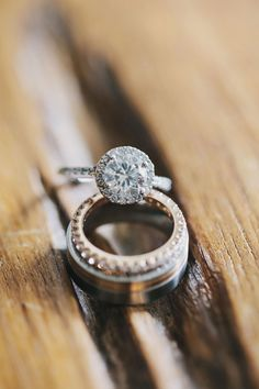 round diamond with pavé setting, photo by Clean Plate Pictures http://ruffledblog.com/romantic-brooklyn-winery-wedding #rings #jewelry #engagementrings