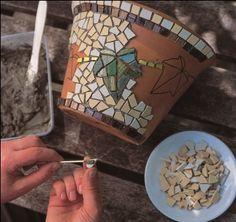Dress up a plain terra cotta pot with an ivy mosaic - get instructions from favecrafts.