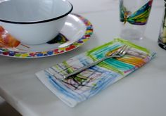 Color cloth napkins with iron-on pastels. Permanently colors the napkins.