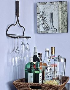 rake upcycled into a wine rack - love it!