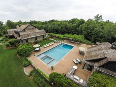 An aerial view of this home's backyard, pool, and guest house.