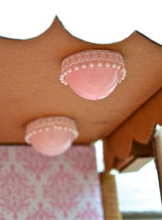 These are pink plastic easter egg halves with pom-pom trim. BARBIE HOUSE
