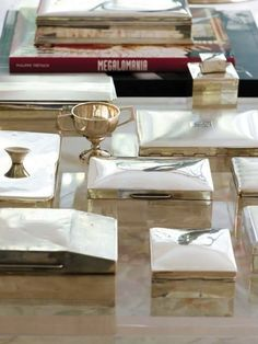 silver boxes displayed on coffee table