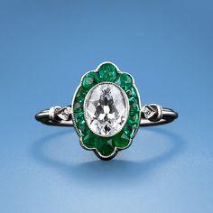 Art Deco Oval Cut Diamond ring w/ Emeralds