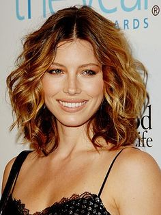 """Medium-length styles were stigmatized as """"mom hair"""" for years...but they're back, big-time! Shoulder-length hair can flatter almost any face shape (when cut correctly!) and has so many styling possibilities: you can curl and pin it up into a faux bob for a retro look, wear it in a ponytail or updo, or add beachy waves to amplify texture and add volume. short hair, hair colors, summer hair, medium length hairstyles, jessica biel, short curly hair, long bobs, highlight, mom hair"""