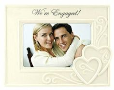 """Here's a lovely Ceramic 4 x 6 engagement photo frame from Malden featuring the """"We're Engaged!"""" theme. #engaged #wedding #engagement #gifts"""