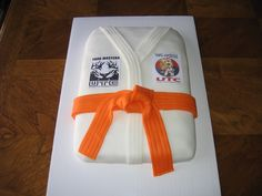My son's birthday cake that I made with patches from Yang Master's United TaeKwonDo Center on it.
