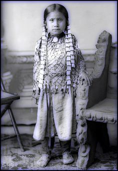 """A delightful photograph of Sitting Bull's beautiful daughter Standing Holy. """"Let us put our minds together and see what life we can make for our children."""" Chief Sitting Bull."""