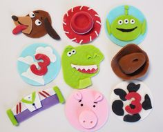 Edible Toy Cupcake Toppers Toy Rex, toy dog, space ranger, pig, cowboy hat, red cowgirl hat, cloud topper, cowprint topper 24 qty. $36.00, via Etsy.