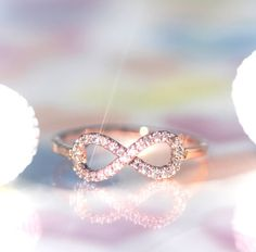 And this infinity WEDDING band. I'd like one strand of the loop to be rose gold and the other yellow gold... Idk if that's possible but it would represent husband and wife. The solid silver engagement band represents God, at the center and strength of our infinite love. It's a promise to God <3