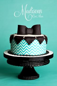 Turquoise chevron cake with black bow-tie.....it's almost too beautiful to consider eating...almost.