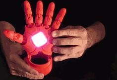 """This 3D-printed Iron Man hand comes with Bluetooth connectivity, a battery, USB charger and Arduino technology, a computing tool that senses the physical world. By tilting one's hand back, the user activate """"thrusters,"""" which are actually LED light displays."""