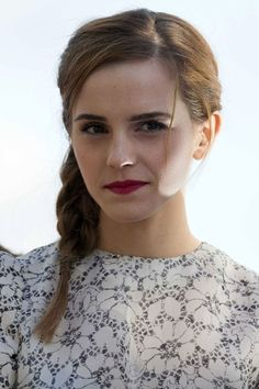 Cannes Film Festival 2013  Emma Watson wore her hair in a pretty side plait, complemented by matte lipstick in a berry hue, for an appearance on the Le Grand Journal Canal + TV stage.