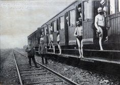 """The original caption of the picture taken from the Berliner Illustrirten Zeitung (Berlin illustrated newspaper) from 1915 reads """"The Bath Train in use after arriving at the location of a regiment. The train with a water wagon travels from camp to camp offering 1000 soldiers a day a chance to bath."""" Photo: Berliner Verlag / Archive - NO WIRE SERVICE"""