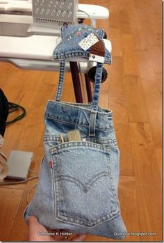 Repurose those jeans into a cute traveling pincushion/caddie/trash-catcher!  CUTE!!