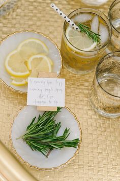 Rosemary gin fizz ~ rosemary, shot of gin, simple syrup, champagne to top (& a slice of lemon)